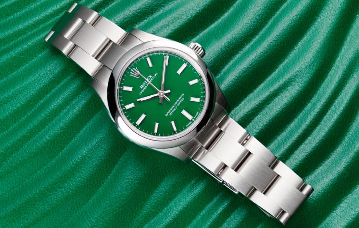 36mm Rolex Oyster Perpetual with green dial on a green Rolex box