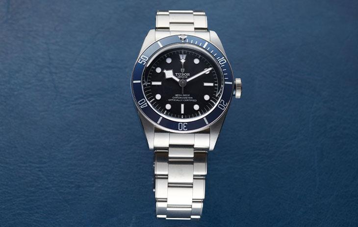 Tudor Black Bay 41 with blue bezel and black dial on a blue background