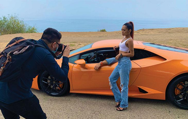 Photographer Oscar Baez snapping a shot of Danica Janae and Kyle Car wearing luxury watches in the Lamborghini Huracan