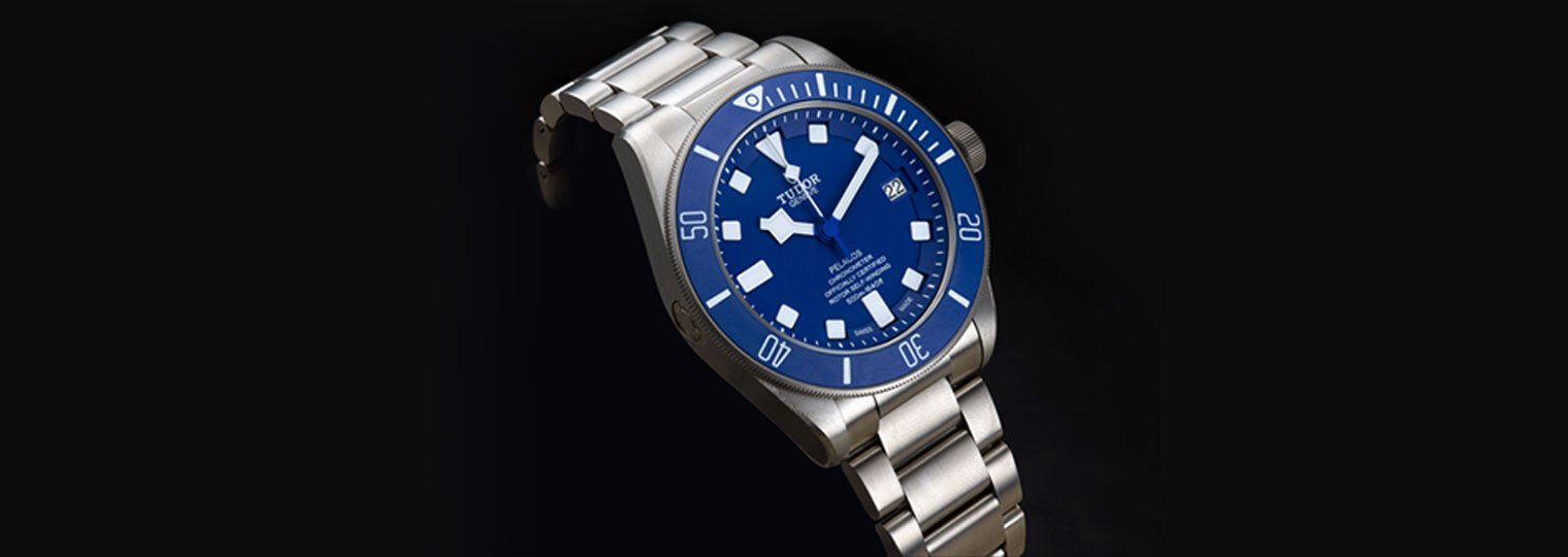 Tudor Pelagos with a blue dial, blue bezel, and stainless steel bracelet.
