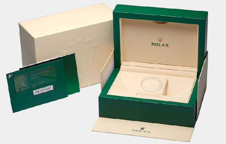 Rolex watch box, warranty card, and booklet.