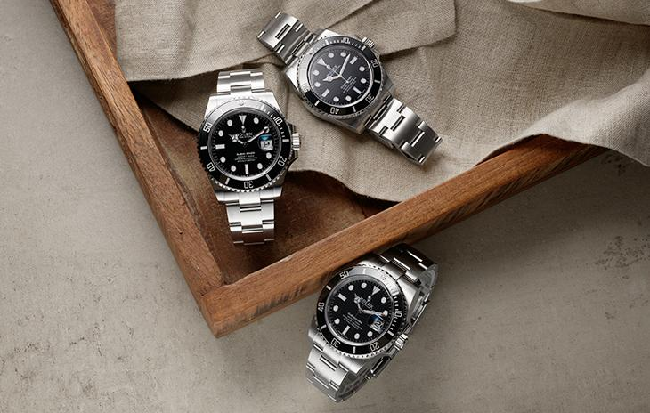 3 Rolex Submariners with black dials, black bezels, and Oyster bracelets