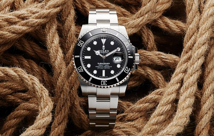 Rolex Submariner Date with black dial and bezel on ropes