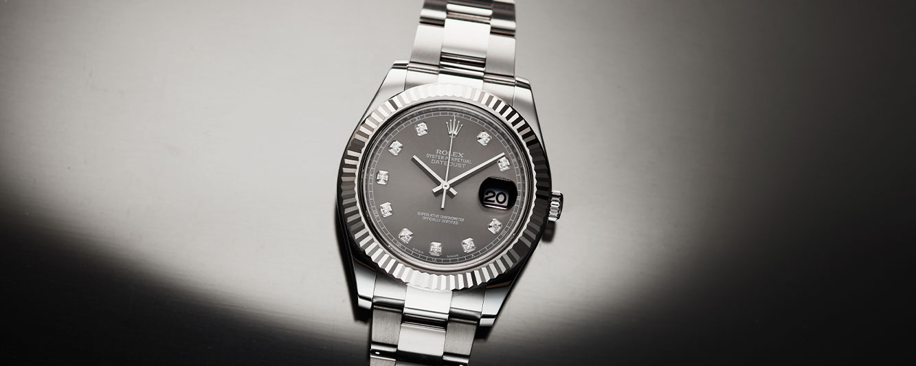 Rolex Datejust with silver dial, diamond set markers, and fluted bezel