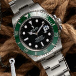 Rolex Submariner Date with green bezel, black dial, and oyster bracelet